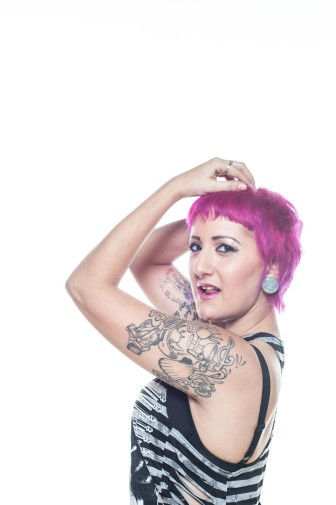 awesome headshot of cool tattoed woman by JnK Imagery